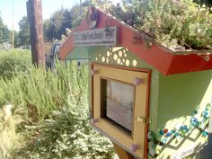 little free library with a green roof