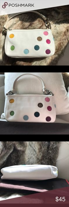 💝Sale💝Coach  leather mini bag Cute white leather mini bag with a sprinkle of color. Sliver hardware zipper closure, Coach signature tan interior. One zip pocket inside. Perfect condition like New Coach Bags Mini Bags
