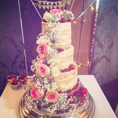 Naked wedding cake with cascading flowers