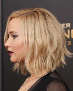 Actress Jennifer Lawrence hair detail attends the 'The Hunger Games Mockingjay Part 2' New York premiere at AMC Loews Lincoln Square 13 theater on...