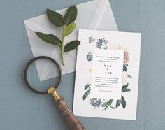 Vintage florals, pastel hues and modern accents combine to create this botanically inspired invitation suite. Complete with transparent vellum envelopes. - - - - - > This listing is for purchasing a non-customized SAMPLE of this invitation set - To order your own invitations