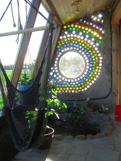 Bottle wall window in Solarium. Bottle wall window in Solarium. Bottle House, Bottle Wall, Earth Bag Homes, Earthship Home, Recycled Wine Bottles, Ways To Recycle, Natural Building, Glass Bottles, Plastic Bottles