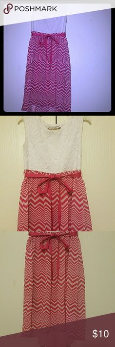 Girl's Pink and White Dress White lace at the top. Pink and white chevron pattern at the bottom with a pink ribbon. Materials: lace and chiffon. Great dress for church or going to a birthday party. Speechless Dresses Casual