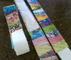 a twist on paper piecing. She pieced scraps onto a roll of adding machine tape 2 3/4″ wide. When trimming the edges, she measured an additional 1/4″ in to each side and machine basted down each outer edge of the paper tape. It made removing the paper easier and kept the pieces from stretching too much … also gives you a seam line to follow when joining the patterned white strips