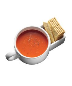 Soup and Crackers Mugs  Enjoy soup season curled up on your sofa with this nifty ceramic bowl. The built-in pocket houses the requisite side of saltines or mini grilled cheese. Microwave- and dishwasher-safe.  To buy: $12 for two, vat19.com.