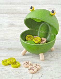 Shop Feed A Frog Kids Game.  Divide into two teams and throw a bug token for the hungry frog.  Each team takes a turn until all tokens are played.  The team that feeds the frog with the most bugs is the winner.