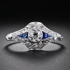 Gorgeous way to have a small center stone: .40 Carat Diamond and Calibre Sapphire Engagement Ring