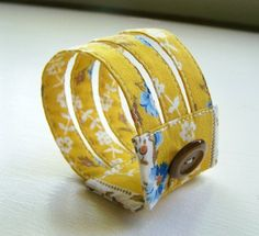 Fabric bracelets: Darling way to showcase that scrap of pretty fabric floating around in your stash.