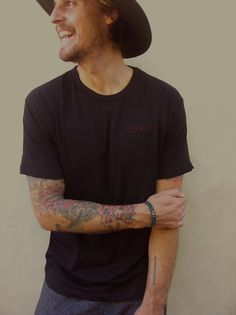 100% COTTONMADE IN U.S.A. Black cap collar, loose fitting crew neck, holds its form.