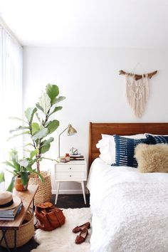 At Home with New Darlings // West Elm furniture, white bedding, shibori throw pillows, macrame wall hanging, plant in basket - every trendy things out there, but it looks good!