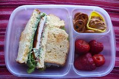 Chicken BLT, along with strawberries, and gluten-free pretzels and peanut butter.