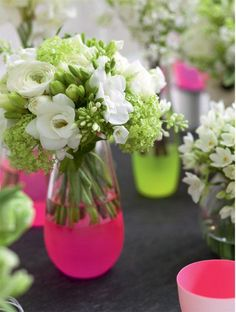 Pretty neon vases filled with white blooms from http://www.philippacraddock.com/