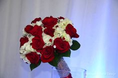 Red roses and white hydrangeas bouquet with Rhinestone wrap on bouquet handle perfect for Winter weddings, Indian or Pakistani weddings.