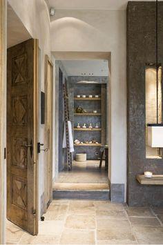 Stone Floors, antique door, plaster walls - exactly the combination I was looking for