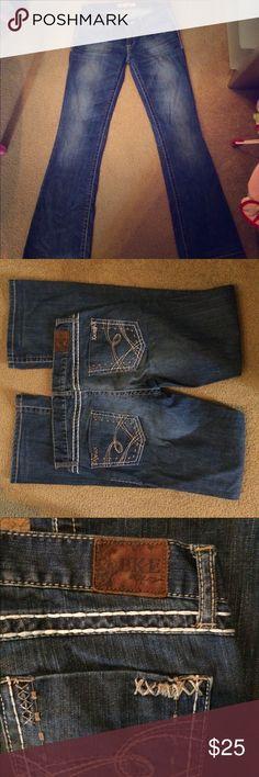 BKE Denim by Buckle Stella boot cut jeans Beautiful denim by Buckle. Stretches nicely. 30x33 1/2 Buckle Jeans Boot Cut