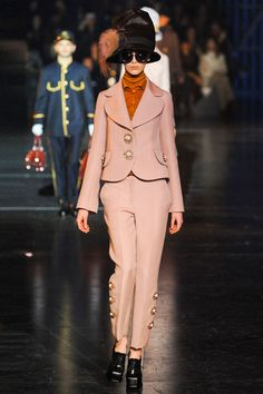The Item: Suit Up    Forget the statement skirt, this season it's all about the pantsuit. Whether it's a cropped and flared retro pair, or a modern layered ensemble, designers resurrected the pantsuit for fall.     Louis Vuitton