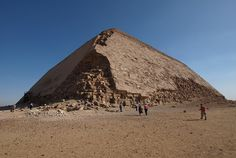 "Bent Pyramid  Bent Pyramid Dashur (Egypt) The Bent Pyramid, of Old Kingdom Pharaoh Sneferu, is a unique example of early pyramid development in Egypt, about 2600 BC. This was the second pyramid built by Sneferu. The lower part of the pyramid rises from the desert at a 55-degree inclination, but the top section is built at the shallower angle of 43 degrees, lending the pyramid its very obvious ""bent"" appearance."