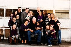 large family pose - in front of the barn garage? *i like jeans and black better than jeans and white*