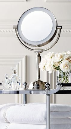 This LED-illuminated vanity mirror has a beautiful articulating head that adjusts to meet your specific height needs.