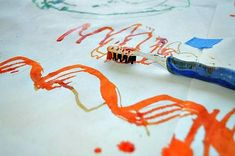 Process: painting with motorized toothbrushes