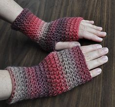 "These fingerless gloves are pretty darn quick to crochet. They look lovely in 629 ""Cherries Jubilee"". Make these in several colorways to match your wardrobe moods."