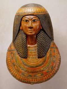 Mummy Mask of Khonsu  Period: New Kingdom, Ramesside Dynasty: Dynasty 19 Reign: reign of Ramesses II Date: ca. 1279–1213 B.C. Geography: From Egypt, Upper Egypt, Thebes, Deir el-Medina, Tomb of Sennedjem (TT 1), Egyptian Antiquities Service/Maspero excavations, 1885–86 Medium: Painted wood and cartonnage  Dimensions: h. 48 cm (18.7/8 in)