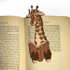 20 Cute Giraffe Gifts for Animal Lovers – Exotic Animal Supplies Unique and fun giraffe gifts for animal lovers or anyone who appreciates these graceful animals. Funny gift ideas and cute animal gifts perfect for birthdays or Christmas. Creative Bookmarks, Handmade Bookmarks, Cute Giraffe, Giraffe Decor, Watercolor Bookmarks, Leather Bookmark, Literary Gifts, Leather Books, Cow Leather