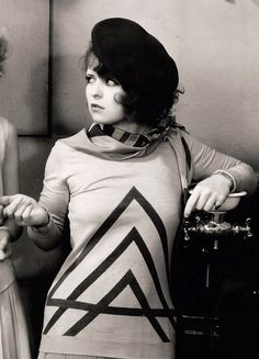 """Clara Bow in """"The Wild Party"""" (Dorothy Arzner, 1929) - Wild girls at a college pay more attention to parties than their classes. But when one party girl, Stella Ames, goes too far at a local bar and gets in trouble, her professor has to rescue her. Gossip linking the two escalates until Stella proves she is decent by shielding an innocent girl and winning the professor's respect."""