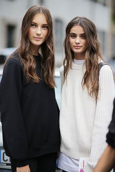 Comfy casual over sized sweaters and wavy locks.