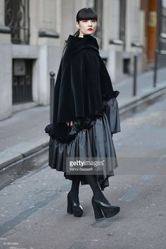 <a gi-track='captionPersonalityLinkClicked' href=/galleries/search?phrase=Kozue+Akimoto&family=editorial&specificpeople=5939879 ng-click='$event.stopPropagation()'>Kozue Akimoto</a> poses wearing Comme des Garcons before the Comme des Garcons show during Paris Fashion Week FW 16/17 on March 5, 2016 in Paris, France.