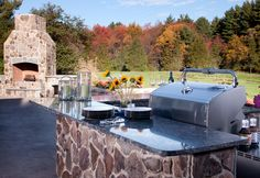 Outdoor counters in Sapphire Blue granite with eased edges. Rustic Outdoor Kitchens, Outdoor Kitchen Design, Outdoor Kitchen Countertops, Concrete Countertops, Blue Granite, Engineered Stone, Kitchen Pictures, Kitchen Ideas, Outdoor Furniture Sets