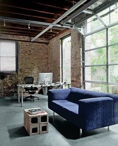 LIVING ROOM // loft space w/ garage door windows. I would so love to move my kitchen downstairs and have this off the back of the house.