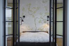 Interior door that is not the boring standard one in a beautiful bedroom renovation in Bucharest.