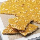Try the Peanut Brittle Recipe on williams-sonoma.com make with pumpkin seeds, cinnamon and nutmeg or try a pumpkin pie spice instead!