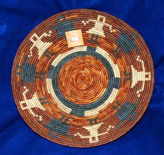 """A beautiful finely woven basket in the southwestern / Native American tradition. 14.5"""" diameter x 2.5"""" depth  So pretty, you can hang it on your wall as a decorative accent! $24.95 #basketry #basket #handwoven #homedecor"""