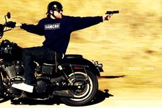Pin for Later: 38 Sexy Reasons We Miss Charlie Hunnam on Sons of Anarchy That time he shoots a gun backward while riding a motorcycle.