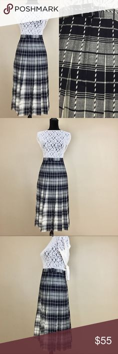 Vintage 70s Pendleton Navy White Plaid Wool Skirt Vintage 1970s Pendleton Navy & White Tartan Plaid Wool Midi Pleated Circle Skirt. This preppy schoolgirl-esque USA made Pendleton skirt is made of pure wool with an all over navy and white plaid print. Stretchy waistband for a comfortable fit. Has a body flattering circle skirt, a-line silhouette. In excellent vintage condition with one minor mark of wear, tiny hole inside of inner waistband (pictured). Not seen while worn. Please see last…