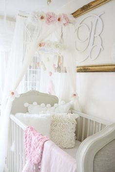 This tiered flower mobile/crib canopy is such a super sweet and girly touch!