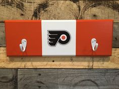 A personal favorite from my Etsy shop https://www.etsy.com/listing/459940358/philadelphia-flyers-2-hook-hat-coat-rack