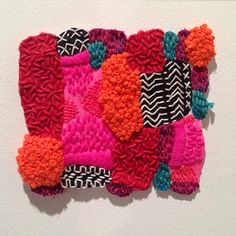 Hand embroidered textile square by Liz Payne