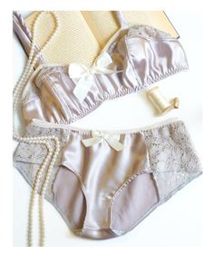 I seriously want everything from this store. And I want to learn how to sew lingerie. Amethyst Smoke Satin & Lace Soft Bra and Panties Set Made to Order. $80.00, via Etsy.