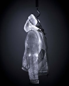 Nemen - L.E.D Jacket // 'The outer fabric is a monofilament of nylon and steel with a polyurethane transparent film which, while working as a shield to protect the optical fibers, emphasizes the depth effect created by light passing through it. The inner fabric features a special aluminum coating which reflects body heat in order to ensure maximum protection from cold weather and wind, while the inner membrane insulates the body guaranteeing protection even in extreme weather conditions.'…