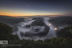Im glad to introduce Morning View II on Germanys Horseshoe Bend called Saarschleife.   After shooting the photo Morning View in May this year i began to plan the next one and decided to wait until october to get some mist like this in the morning. many tries and lots of sunrises later i finally got the conditions ive been waiting for.  I decided to take the photo about 20min. before sunrise. luckily the sky was clear and the moon was alone on the sky and continued with some different shots…