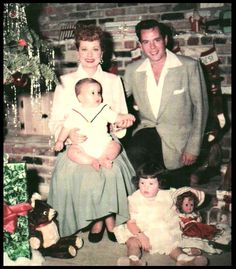 Lucille Ball with husband Desi Arnaz   and their children Lucie Desiree and Desi Jr.  Christmas 1953