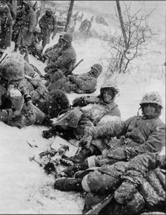 1st Marine Division - Chosin Few - 1950  Marines Take a Break on the Breakout  These young heroes can still give a smile for the camera. Try lugging that mortar base and tube in temperatures of -45 degrees F.