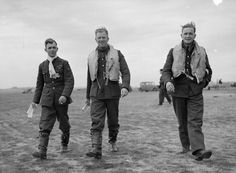 """F/Sgt George C """"Grumpy"""" Unwin, acting F/L Walter J """"Farmer"""" Lawson and Sgt David E Lloyd (left to right) of No 19 Squadron RAF hand a line to AM photographer Stanley Devon at RAF Fowlmere on 21 September 1940. Lloyd shared a Ju 88 on 18 September, 6 days after being posted to the satellite airfield. Lawson claimed 6 and 1 shared destroyed, 3 probables and 1 damaged during his 16 months with the unit."""