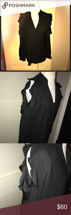 Ann Taylor Black Blouse (Size M) This Black blouse has never been worn. It has the cut out shoulders that give it a chique look. It is 💯 polyester and is flattering on all shapes. Ann Taylor Tops Blouses
