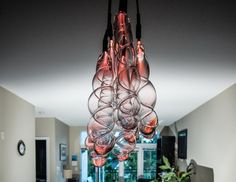 Slinky Pendant Light by Sasamat Creative September 27 2014 Vancouver-based Sasamat Creative have designed Slinky, a hand blown glass pendant light.