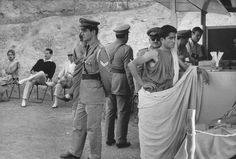 """Henri Cartier-Bresson GREECE. Peloponnese. Epidaurus. 1961. Theater festival. Interval during the play """"Medea"""" (Maria CALLAS in the main role). Costumes designed by the Greek painter TSAROUCHIS, Image Reference © Henri Cartier-Bresson/Magnum Photos"""