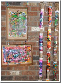 Tube prints: glue paper towel to a paper towel tube; squirt paint in cardboard box; roll tube through paint; display both tube and box (in picture, tubes are on lengths of paper)